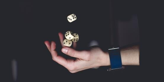 person-about-to-catch-four-dices-1111597